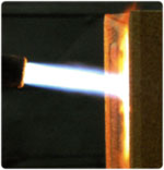 A block of FIREX 600 is subjected to an oxyacetylene flame.